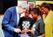 2016 STEM Summer Camp participants, Ruth and Jessica, impress U.S. Secretary of State John Kerry with their STEM skills.